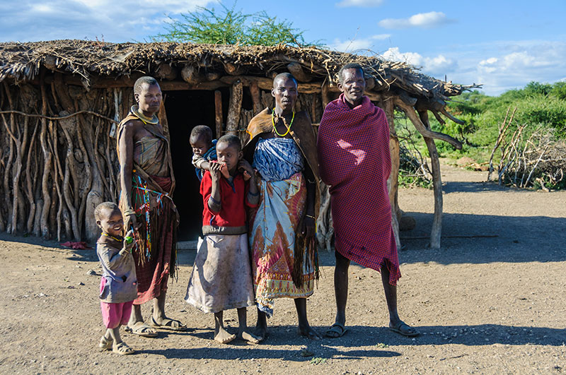 A Datooga family in front of thier home at Lake Eyasi.