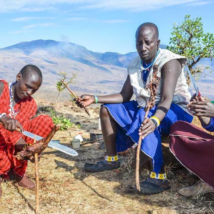 KopeLion team mebers Roimen Lelya, Letiro Niini and Julius Kinini sharing the grilled leg of a goat