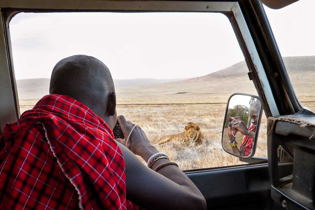 Ilchokuti Roimen photographing Gene pool male in the Ngorongoro Crater.