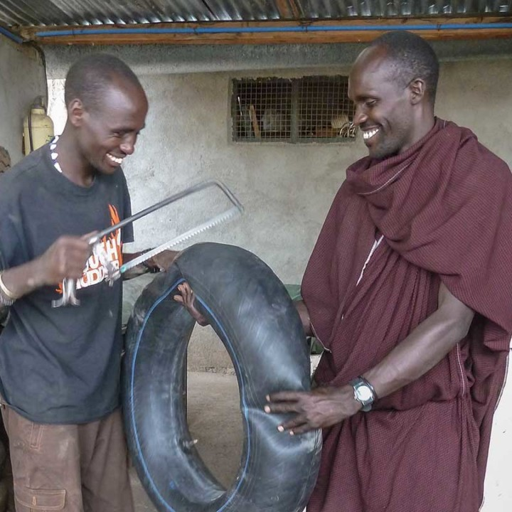 Learning by doing. Here with support from Ndutu Lodge garage, KopeLion staff Roimen and Kitasho fix a puncture.