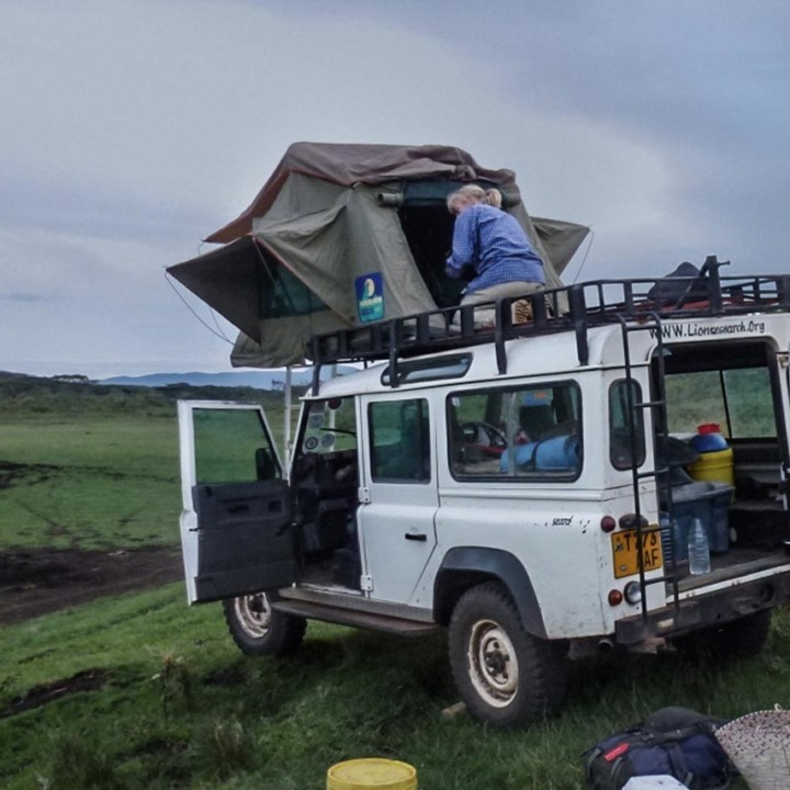 Setting up camp for the night – where ever night catches up after a day of field and community work.