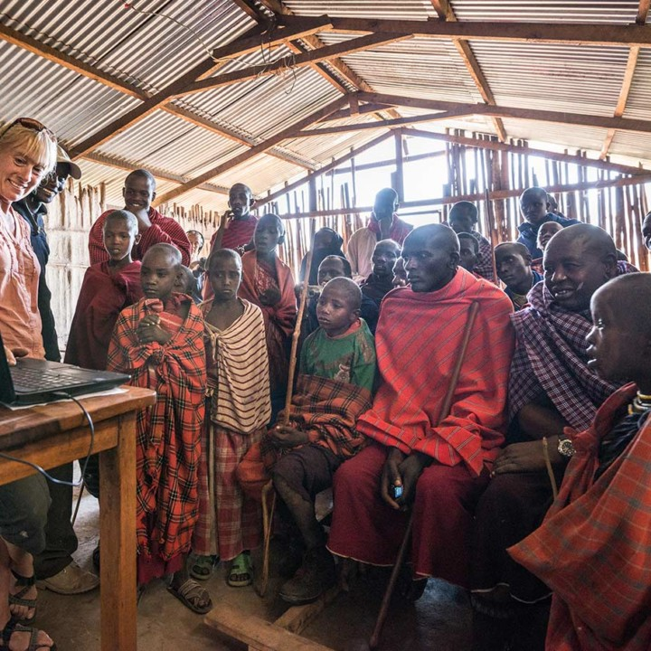 We reach out to the Maasai commuinity. Here we are presenting our work in a school building.